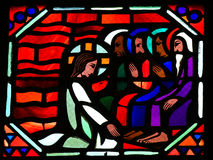 Jesus washing the feet of Saint Peter on Maundy Thursday. Stained glass window depicting Jesus washing the feet of the apostle Peter at the Last Supper on Maundy Royalty Free Stock Images