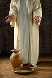 Jesus With Water Jar and Pan Stock Photos