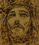 Jesus woodburning art. Jesus on wood, done with woodburning technique known as pyrography Stock Images