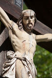 Jesus on a wooden cross. Wooden jesus on the cross, detail royalty free stock photos