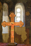 Jesus on a wooden cross. Picture of Jesus on the cross, situated into ancient church with small window in background Stock Images