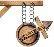 Jesus - Wooden Symbol with Cross. Round wooden symbol with wooden cross with arrow upward and text Jesus. Hanging a wooden pole from a chain and isolated on Stock Image