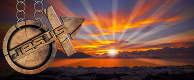 Jesus Wooden Symbol with Cross at the Sunset Royalty Free Stock Images