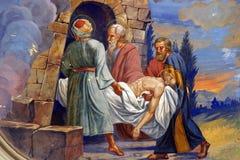 Jesus wordt gelegd in het graf stock foto