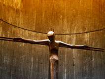 Jesuschrist Statue in a golden background. Ancient statue from a little church from an unknown artist Royalty Free Stock Photography