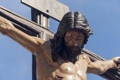 Jesuss död på korset, helig vecka i Seville, brödraskap av studenter Royaltyfria Bilder