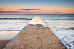 Jetée de plage de Blyth au coucher du soleil photos libres de droits