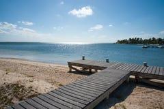 Jetée de plage de Kai de caïman Photos stock