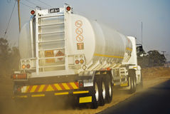 Jet A-1 aka AVGAS Tanker. Jet fuel transported to the airport via road hauling. This tanker driver moves over into the shoulder to allow the faster moving Royalty Free Stock Photo