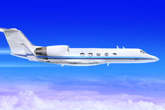 Jet. Private white jet plane in the blue sky Royalty Free Stock Image