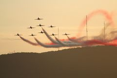 Jet. Red arrows formation fly at air show in Quebec royalty free stock image
