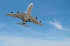 Jet aircraft. Large jet aircraft on landing approach in a blue cloudy sky royalty free stock photo