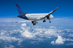 Jet aircraft above the clouds Stock Images