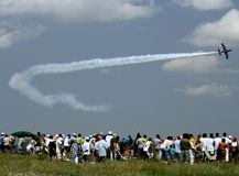 Jet aircraft at an air show in Romania. Jet aircraft and spectators at an air show in Romania Royalty Free Stock Images