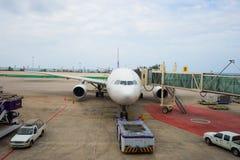 Jet aircraft docked at airport Royalty Free Stock Photos