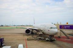Jet aircraft docked at airport Stock Photo