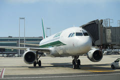 Jet aircraft docked in international airport Royalty Free Stock Photography