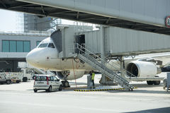 Jet aircraft docked in international airport Stock Images
