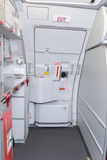 Jet aircraft interior. Door in low cost jet aircraft stock photos