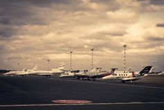 Jet aircraft parked at commercial airport Royalty Free Stock Photography