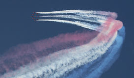 Jet aircraft streaming smoke Royalty Free Stock Image