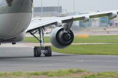 Jet aircraft taxying. Rear view of a jet aircraft taxying Royalty Free Stock Images