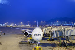 Jet airliner docked in airport. HONG KONG - APRIL 22: Boeing 777 docked in airport on April 22, 2014 in Hong Kong. Hong Kong International Airport  is one of the Stock Photos