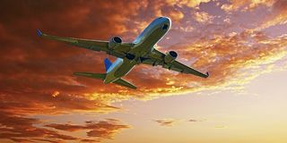 Jet Airliner Flying in an Orange colour Altocumulus cloudy sky. stock photography
