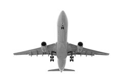 Jet airliner front bottom. Airborne jet airliner in black and white, isolated on white; front bottom view with landing gear deployed Stock Photography