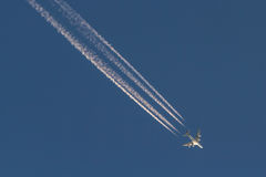 A380 jet airliner streaking across the sky Royalty Free Stock Image