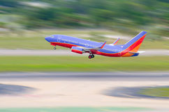 Jet airliner taking off. Colorful jet airliner taking off flying very fast Stock Images
