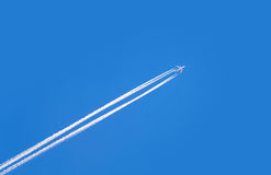 Jet airplane on blue sky Royalty Free Stock Photos