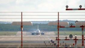 Jet airplane braking after landing. In Dusseldorf stock footage