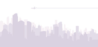 Jet Airplane in the City. Jet airplane cruising above a big city Stock Photo