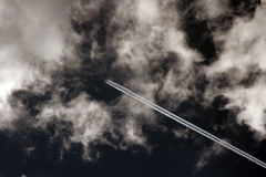 Jet airplane and clouds 2 Royalty Free Stock Photos