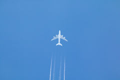 Jet Airplane and Contrail Stock Photos