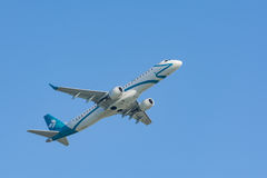Jet airplane Embraer ERJ-195 of Air Dolomiti Italian airlines. Munich, Germany - May 6, 2016: Jet plane Embraer E-Jet ERJ-195 of Air Dolomiti Italian airlines Royalty Free Stock Photos