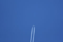 Jet airplane in flight leaving vapour trails Stock Images