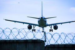 Jet airplane flying overhead close-up Stock Image