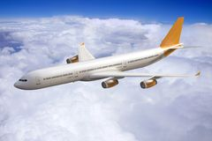 Jet airplane flying in the sky, clouds stock photos