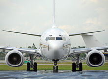 Jet airplane front view. Modern jet airplane on the ground front view Stock Photography