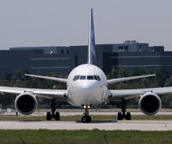 Jet airplane front view. Modern jet airplane front view before takeoff Stock Photo