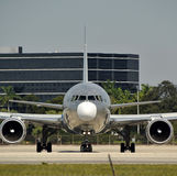Jet airplane front view. Modern heavy lift jet airplane nose view before takeoff Royalty Free Stock Photography