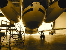 Jet airplane in hanger Stock Image