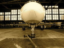 Jet airplane in hanger Stock Photos