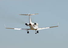 Jet airplane landing Stock Images