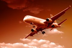 Jet airplane landing Stock Photos