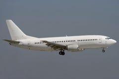 Jet airplane landing. White jet airplane is landing Stock Image