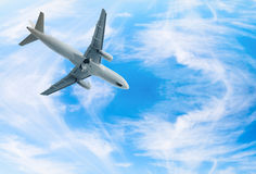 Jet airplane landing in blue sky Stock Photos