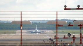 Jet airplane braking after landing. Jet airplane landing and braking in Dusseldorf stock footage